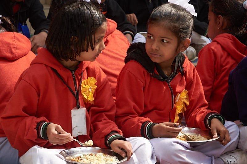 Lunchtime gossip in a slum school
