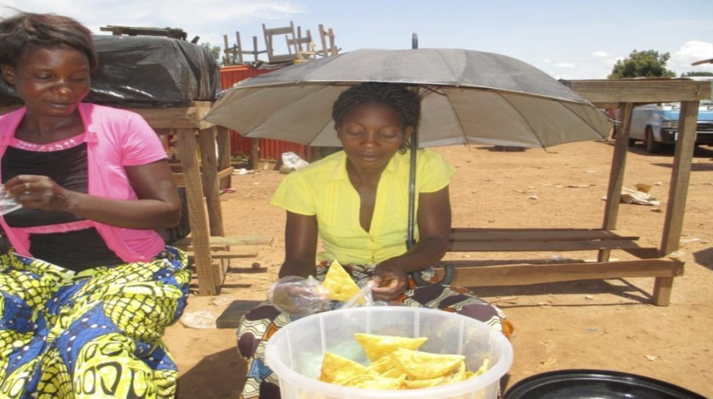 Women baking food to sell in Zambia